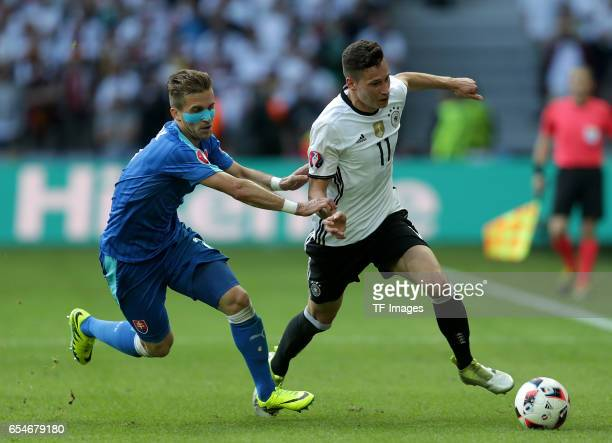 Peter Pekarik of Slovakia and Julian Draxler of Germany battle for the ball during the UEFA EURO 2016 round of 16 match between Germany and Slovakia...