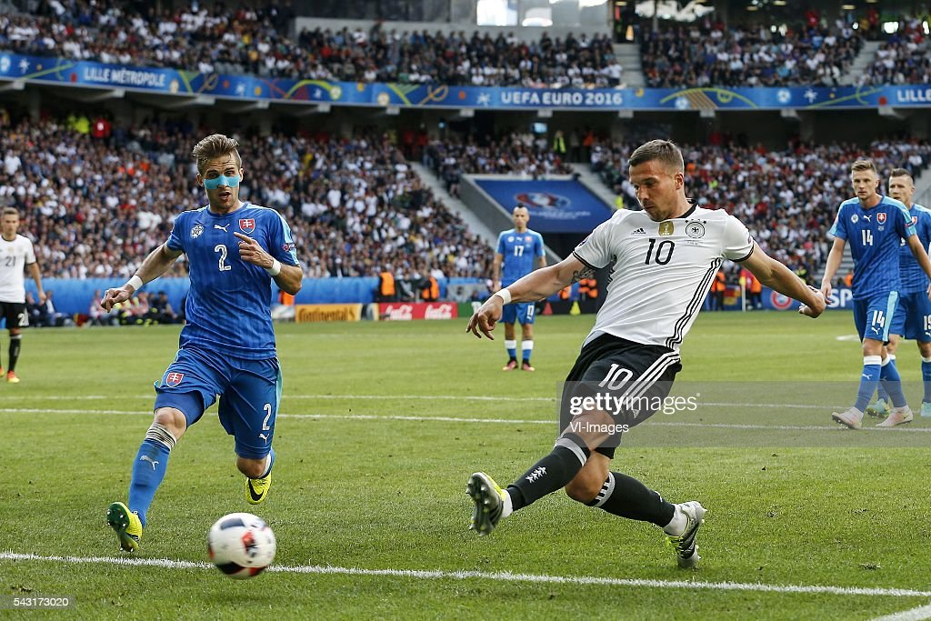 Peter Pekarik of Slovakia, Lukas Podolski of Germany during the UEFA Euro 2016 round of 16 match between Germany and Slovakia on June 26, 2016 at the stade Pierre-Mauloy in Lille, France.