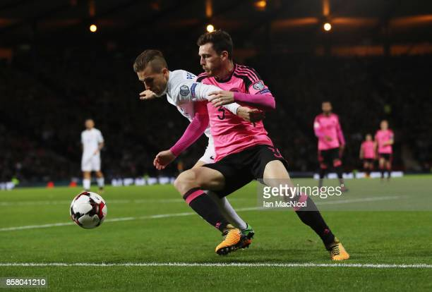 Peter Pekarik of Slovakia vies with Andy Robertson of Scotland during the FIFA 2018 World Cup Qualifier between Scotland and Slovakia at Hampden Park...