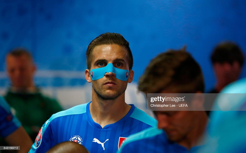 <a gi-track='captionPersonalityLinkClicked' href=/galleries/search?phrase=Peter+Pekarik&family=editorial&specificpeople=5577121 ng-click='$event.stopPropagation()'>Peter Pekarik</a> of Slovakia wearing protective face mask is seen in the tunnel prior to the UEFA EURO 2016 round of 16 match between Germany and Slovakia at Stade Pierre-Mauroy on June 26, 2016 in Lille, France.