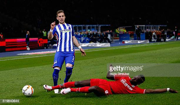 Peter Pekarík of Berlin is tackled by Salif Sane of Hannover during the Bundesliga match between Hertha BSC and Hannover 96 at Olympiastadion on...