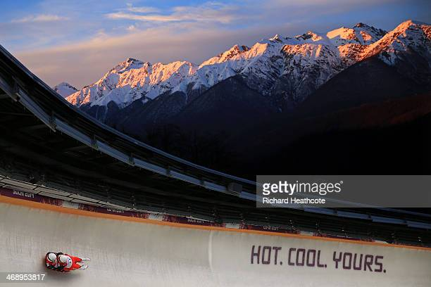 Peter Penz and Georg Fischler of Austria make a run during the Men's Luge Doubles on Day 5 of the Sochi 2014 Winter Olympics at Sliding Center Sanki...