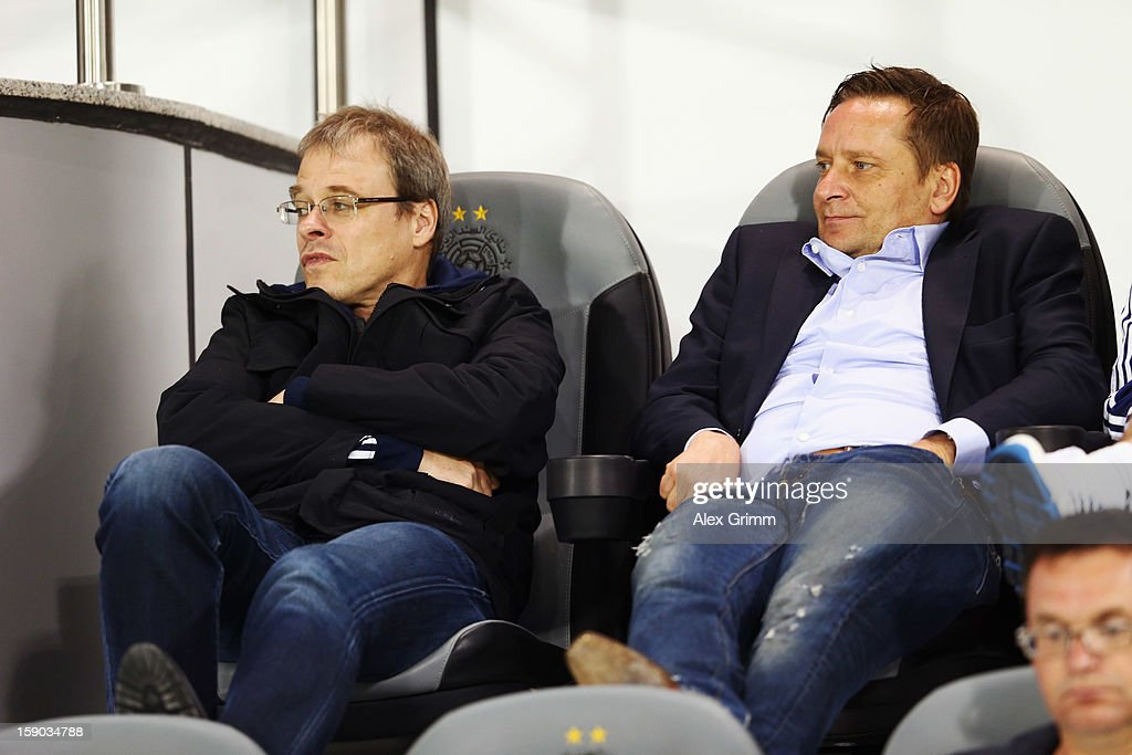 Peter Peters (L) and manager Horst Heldt of Schalke watch the friendly match between Al-Sadd Sports Club and FC Schalke 04 at Jassim Bin Hamad Stadium on January 6, 2013 in Doha, Qatar.