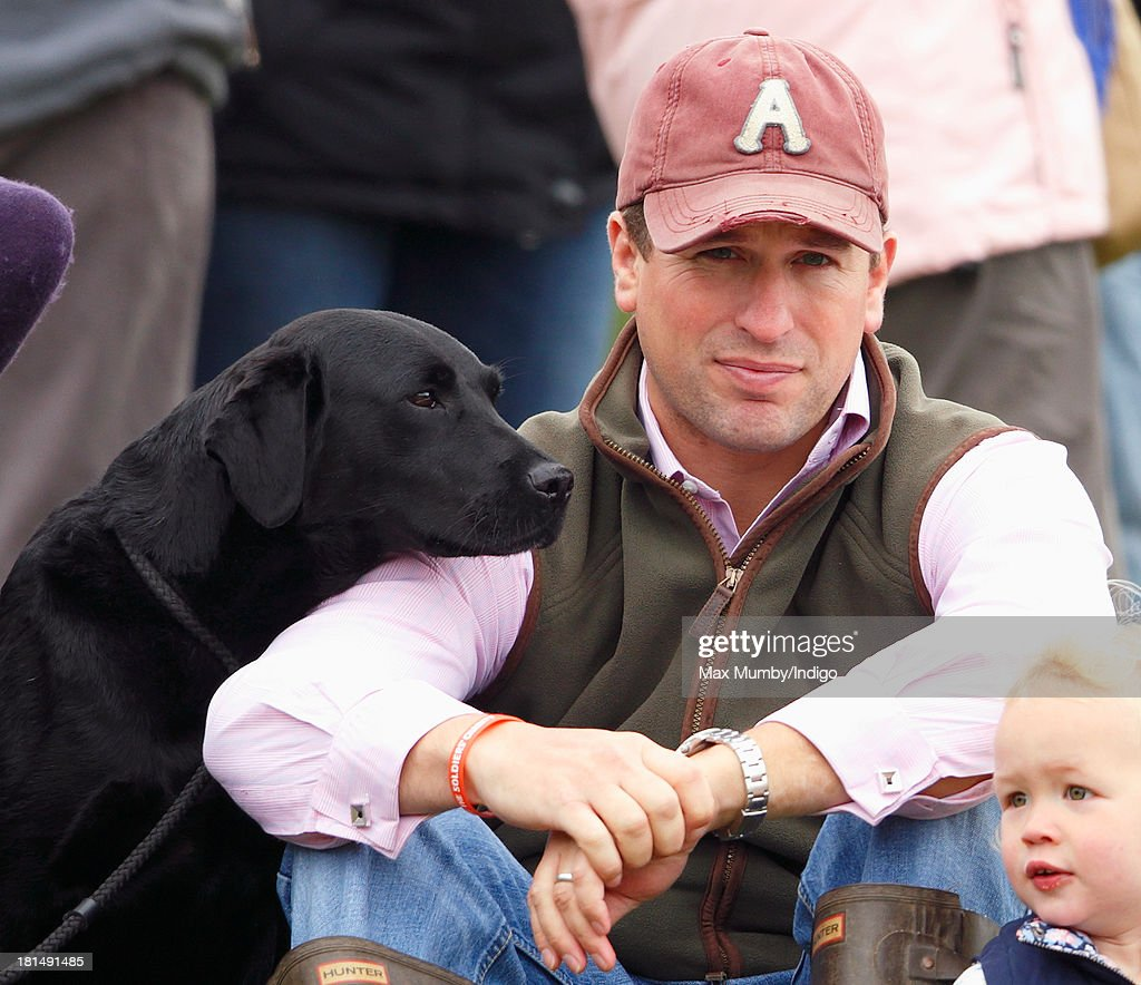 Peter Phillips, accompanied by his dog, watches the cross country phase of the Gatcombe Horse Trials at Gatcombe Park, Minchinhampton on September 21, 2013 in Stroud, England.