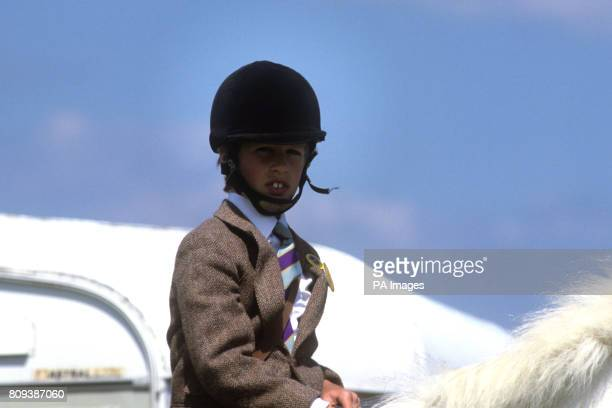 Peter Phillips aged 10 in the saddle of his white pony at a Pony Club event at the Windsor Horse Trials