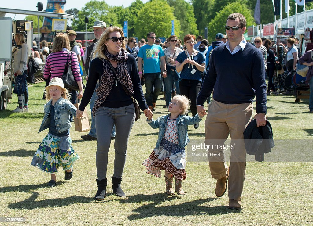 Peter Phillips and Autumn Phillips with Isla Phillips and Savannah Phillips at the Royal Windsor Horse show in the private grounds of Windsor Castle on May 16, 2015 in Windsor, England.