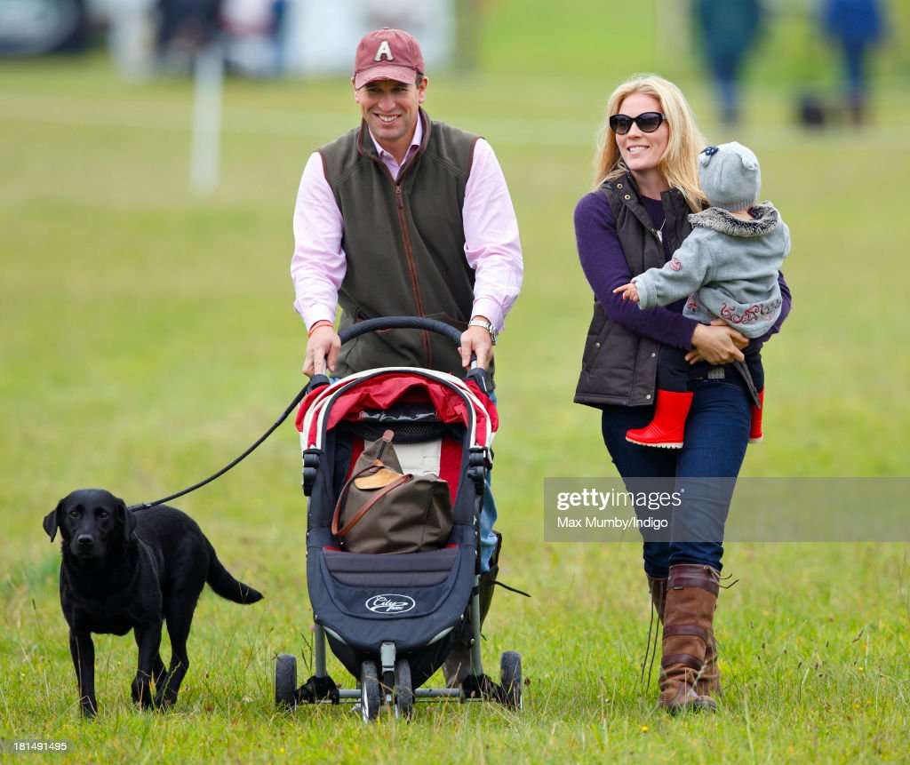Peter Phillips and Autumn Phillips with their daughter Isla Phillips (right) attend the Gatcombe Horse Trials at Gatcombe Park, Minchinhampton on September 21, 2013 in Stroud, England.