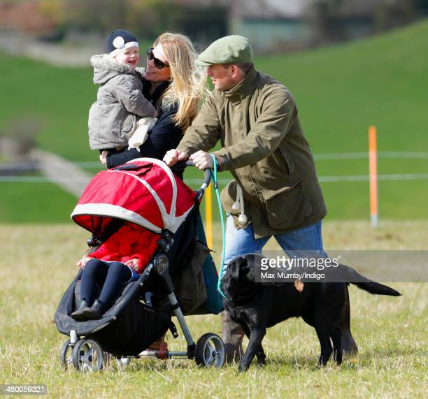 Peter Phillips and Autumn Phillips with their daughters Savannah Phillips Isla Phillips walk the cross country course of the Gatcombe Horse Trials at...