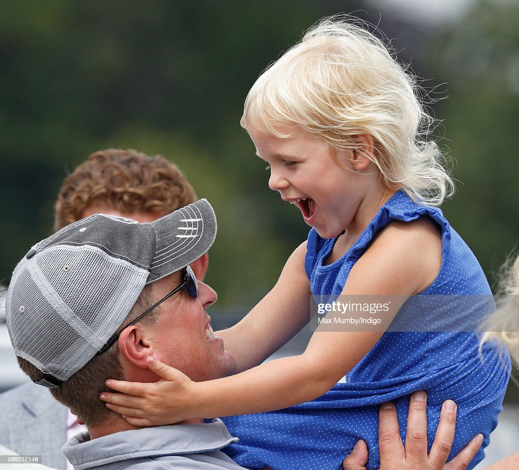 Peter Phillips and daughter Isla Phillips watch Zara Phillips compete in the dressage phase of the Festival of British Eventing at Gatcombe Park on August 5, 2016 in Stroud, England.