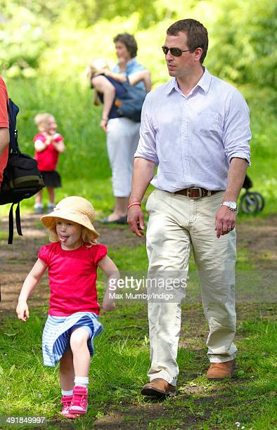 Peter Phillips and daughter Savannah Phillips watch the International Carriage Driving Grand Prix event during day 4 of the Royal Windsor Horse Show...