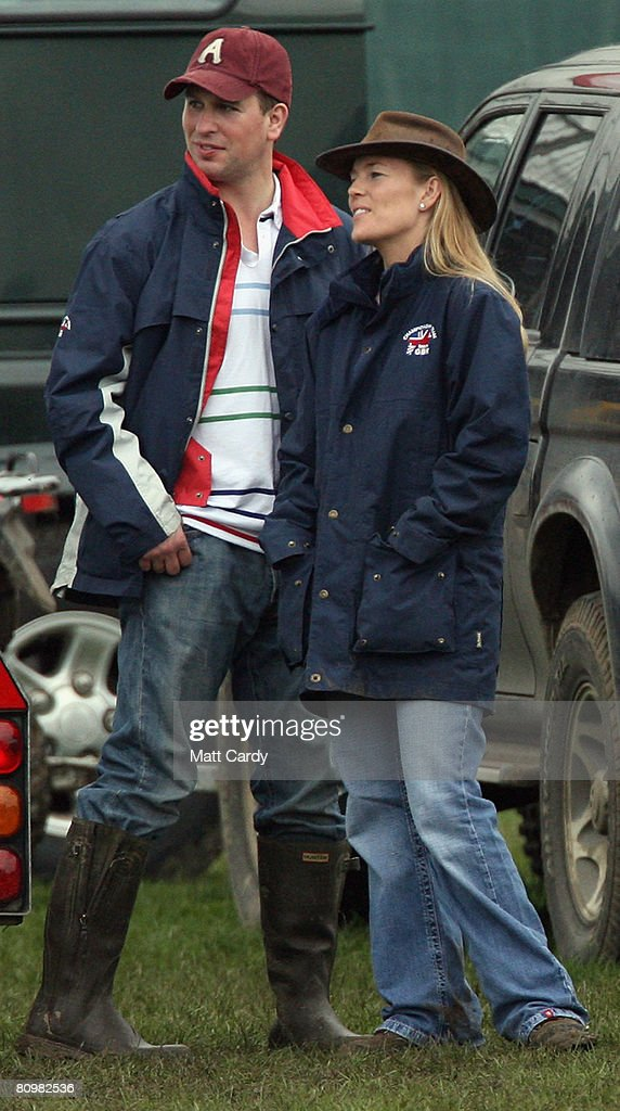 Peter Phillips and his fiance Autumn Kelly watch the show jumping during the Badminton Horse Trials on May 4, 2008 in Badminton, England. Reigning world champion Zara Phillips rode Glenbuck and Ardfield Magic Star at the event - as the British equestrian team looks to finalise their 2008 Olympics squad. The event started with two days of dressage then went into cross country before finishing with the jumping test on today.