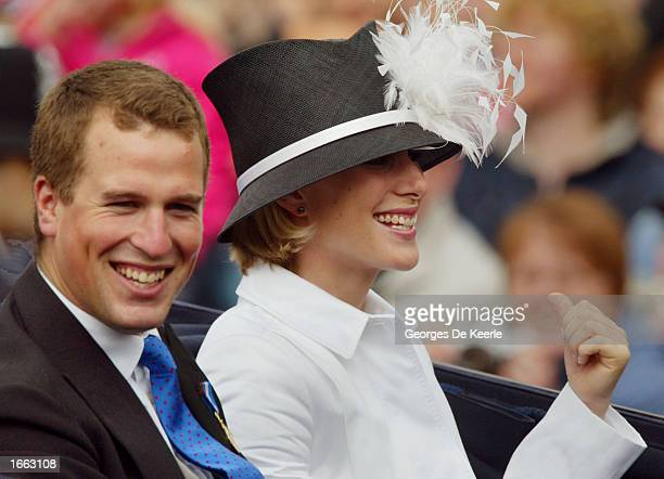 Peter Phillips and Zara Phillips ride in a carriage at the head of a parade from Buckingham Palace to St Paul's Cathedral celebrating the Queen's...