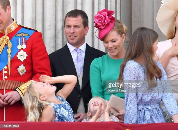 Peter Phillips Autumn Phillips Savannah Phillips and Isla Phillips look on from the balcony during the annual Trooping The Colour parade at the Mall...