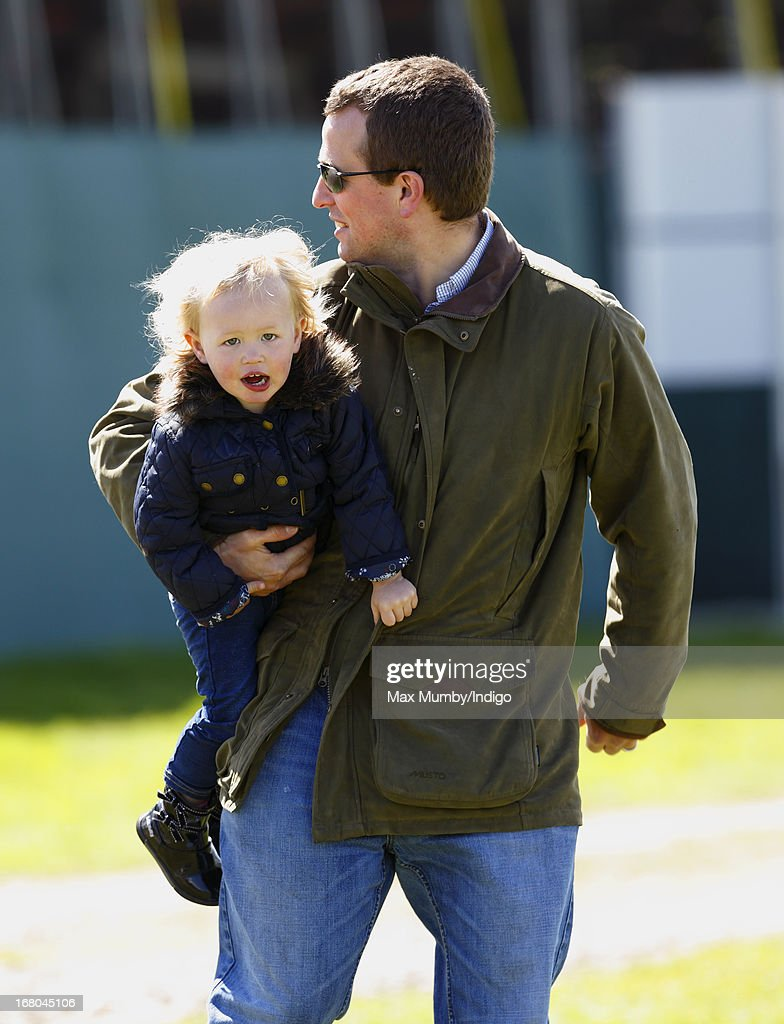 <a gi-track='captionPersonalityLinkClicked' href=/galleries/search?phrase=Peter+Phillips&family=editorial&specificpeople=160043 ng-click='$event.stopPropagation()'>Peter Phillips</a> carries daughter Savannah Phillips as they attend day 3 of the Badminton Horse Trials on May 4, 2013 in Badminton, England.