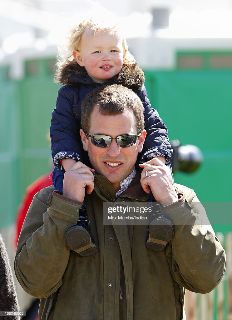 <a gi-track='captionPersonalityLinkClicked' href=/galleries/search?phrase=Peter+Phillips&family=editorial&specificpeople=160043 ng-click='$event.stopPropagation()'>Peter Phillips</a> carries his daughter Savannah Phillips on his shoulders as they attend day 3 of the Badminton Horse Trials on May 4, 2013 in Badminton, England.