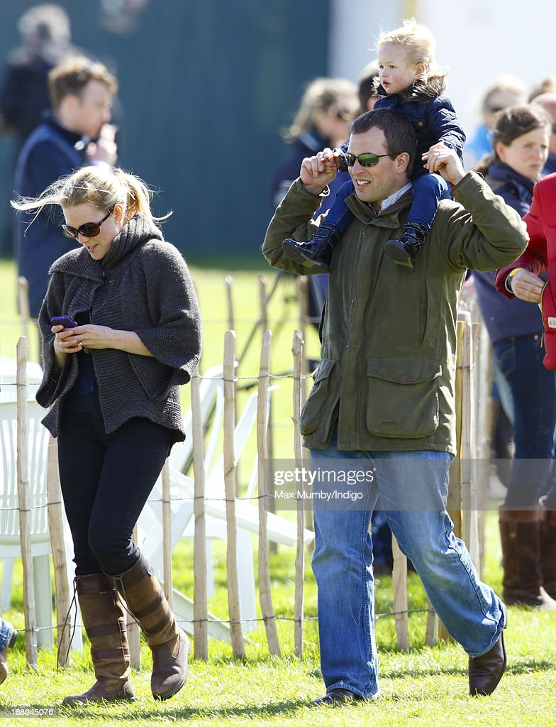 Peter Phillips carries his daughter Savannah Phillips on his shoulders as they and his wife Autumn Phillips attend day 3 of the Badminton Horse Trials on May 4, 2013 in Badminton, England.