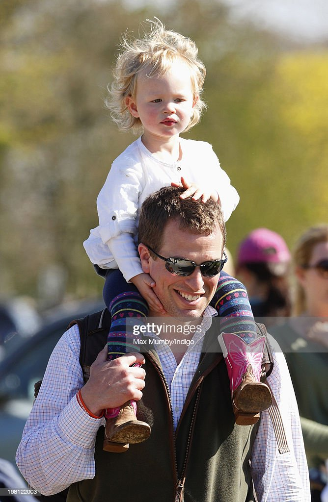 Peter Phillips carries his daughter Savannah Phillips on his shoulders as they attend day 4 of the Badminton Horse Trials on May 5, 2013 in Badminton, England.