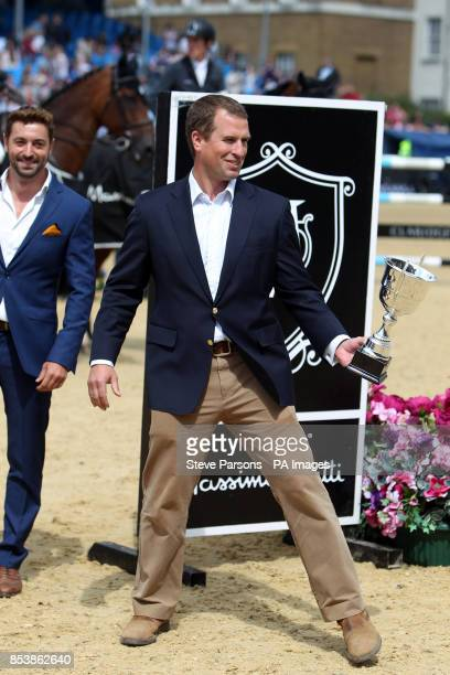 Peter Phillips helps present the awards to the winner of the Massimo Dutti Prix during day three of the 2014 Longines Global Champions Tour at Horse...