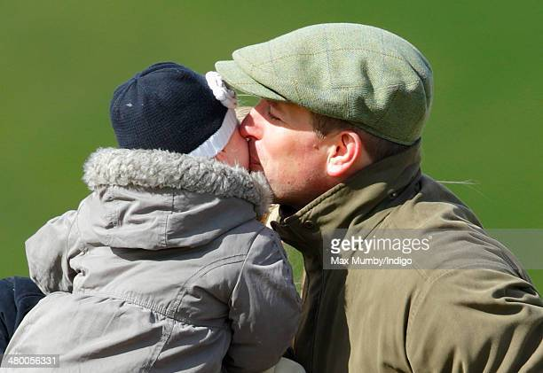 Peter Phillips kisses daughter Isla Phillips as they attend the Gatcombe Horse Trials at Gatcombe Park Minchinhampton on March 22 2014 near Stroud...