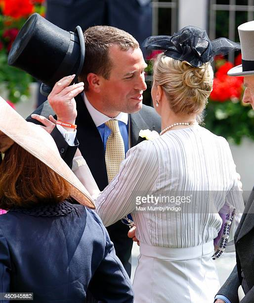 Peter Phillips kisses Lady Helen Taylor as they attend Day 4 of Royal Ascot at Ascot Racecourse on June 20 2014 in Ascot England