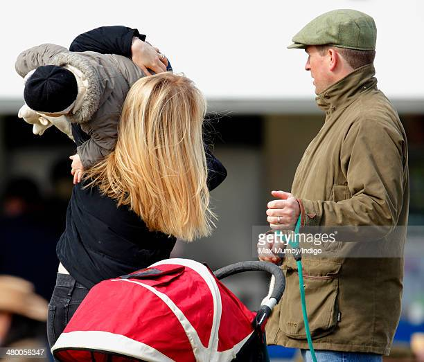 Peter Phillips looks on as Autumn Phillips plays with daughter Isla Phillips as they attend the Gatcombe Horse Trials at Gatcombe Park Minchinhampton...