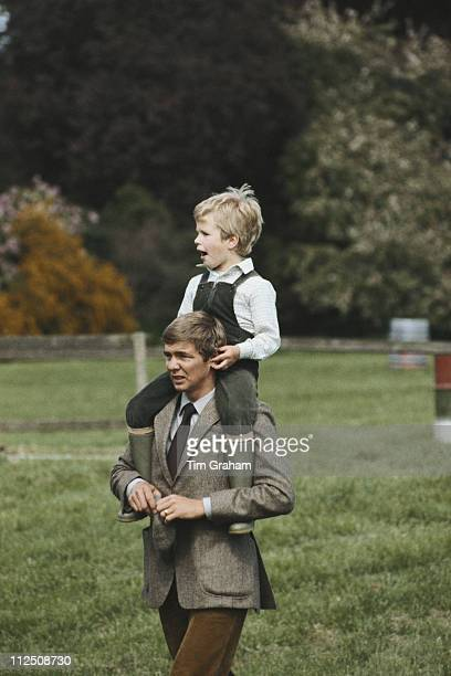 Peter Phillips riding on the shoulders of his bodyguard David Robinson at the Royal Windsor Horse Show held at Home Park in Windsor Berkshire England...