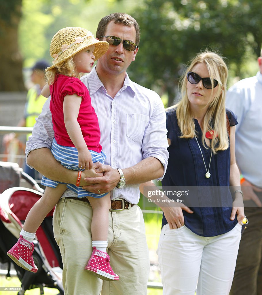 Peter Phillips, wife Autumn Phillips and daughter Savannah Phillips watch the International Carriage Driving Grand Prix event during day 4 of the Royal Windsor Horse Show at Home Park on May 17, 2014 in Windsor, England.