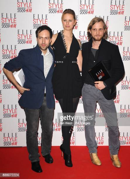 Peter Pilotto with the award for Best New Designer poses with Karolina Kurkova and Christopher De Vos at the ELLE Style Awards 2009 at Big Sky London...