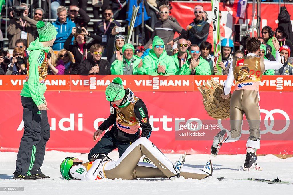 Peter Prevc and Robert Kranjec and Anze Lanisek of Slovenia react after the final jump of Peter Prevc during the FIS Ski Jumping World Cup at Planica on March 20, 2016 in Planica, Slovenia.