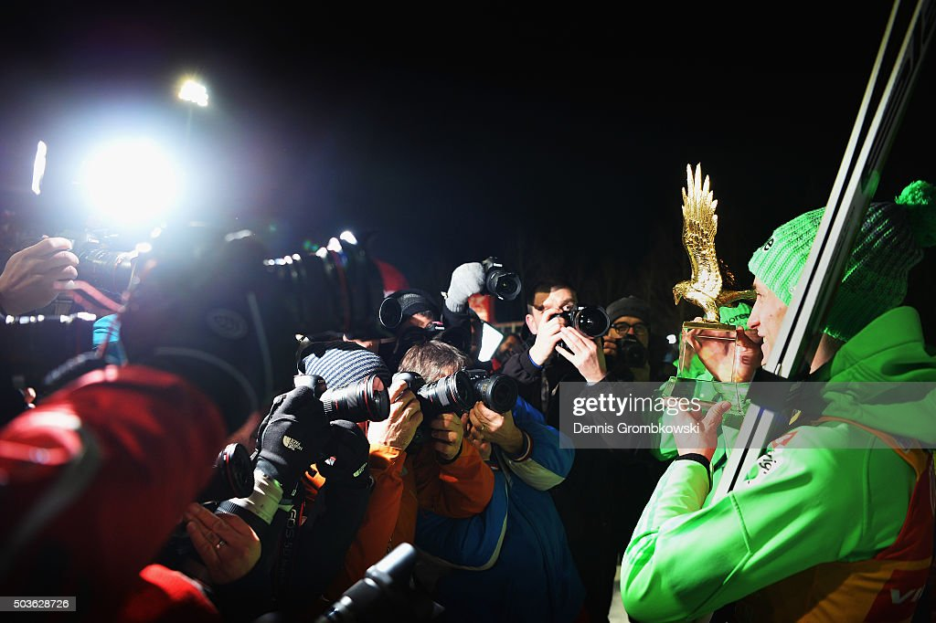 Peter Prevc of Slovenia celebrates with the trophy after his victory in 64th Four Hills Tournament on January 6 2016 in Bischofshofen Austria