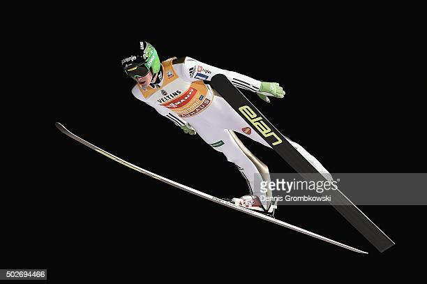 Peter Prevc of Slovenia soars through the air during his qualification jump on Day 1 of the 64th Four Hills Tournament ski jumping event on December...