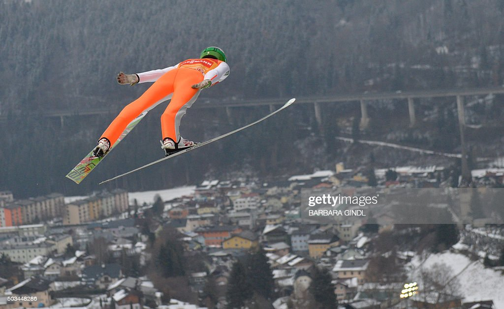 TOPSHOT Peter Prevc of Slovenia soars through the air during the trail jump at the fourth stage of the Four Hills ski jumping tournament in...