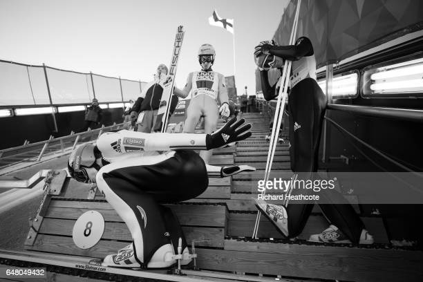 Peter Prevc of Slovenia Stefan Kraft of Austria and Andreas Wellinger of German prepare to jump during the Men's Team Ski Jumping HS130 at the FIS...