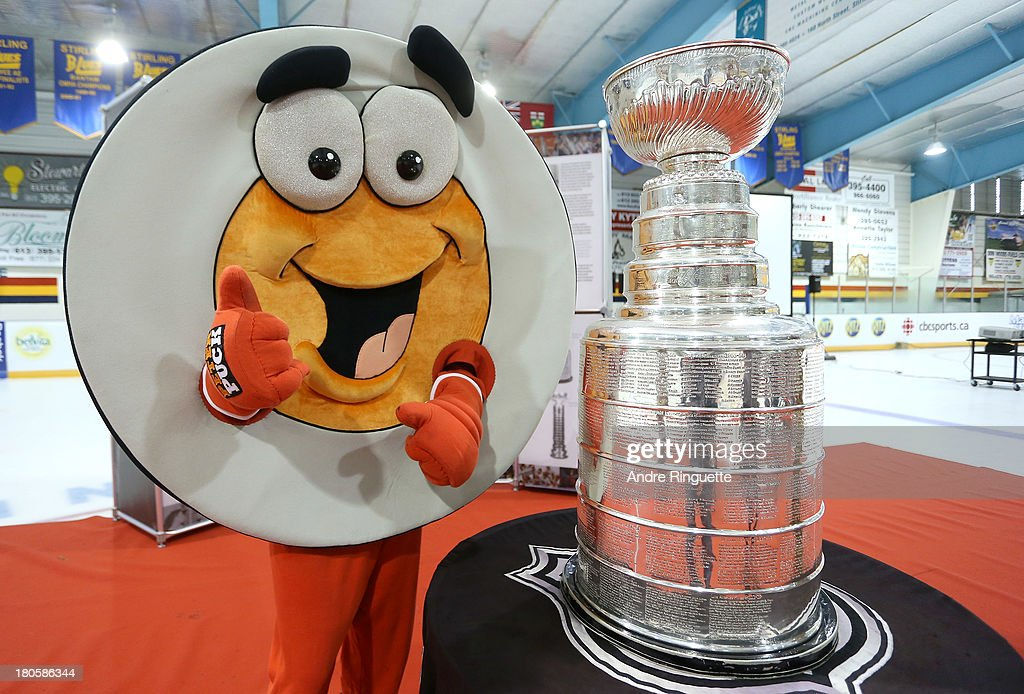 Peter Puck poses with the Stanley Cup at the Stirling and District Recreation Centre during Kraft Hockeyville Day 2 on September 14, 2013 in Stirling, Ontario, Canada.