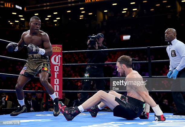 Peter Quillin knocks down Andy Lee during the Premier Boxing Champions Middleweight bout at Barclays Center on April 11 2015 in the Brooklyn borough...
