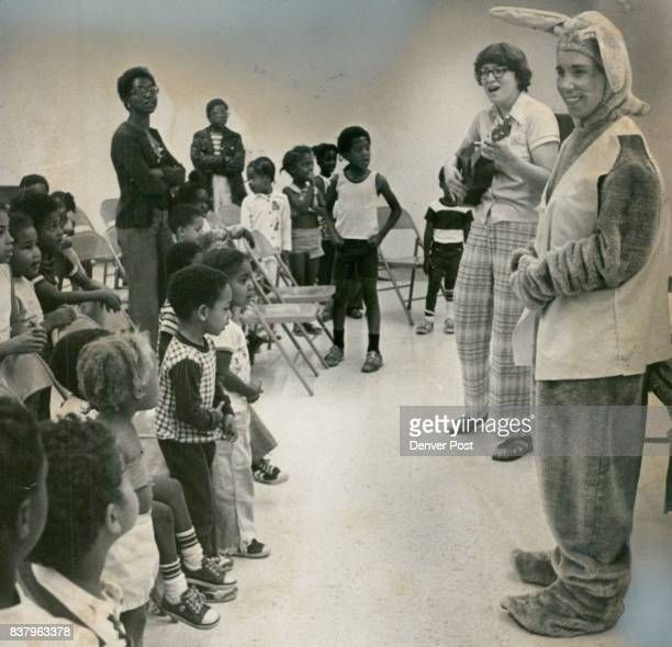 JUN 30 1977 JUL 2 1977 JUL 6 1977 'Peter Rabbit' Helps Celebrate Library Landmark Linda Metcalf left Park Hill children's librarian played guitar as...
