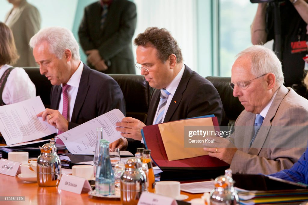Peter Ramsauer, Federal Minister of Transport, Building and Urban Development, Interior Minister Hans-Peter Friedrich and German Finance Minister Wolfgang Schaeuble attend the weekly cabinet meeting at the Chancellery (Bundeskanzleramt) on July 3, 2013 in Berlin, Germany.