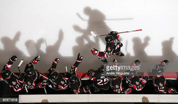 Peter Regin of the Ottawa Senators celebrates a goal against the Edmonton Oilers with teammates Filip Kuba Brian Lee Chris Phillips Chris Campoli...