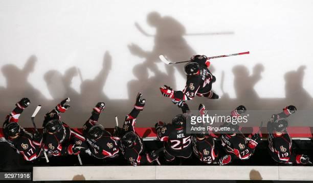 Peter Regin of the Ottawa Senators celebrates a goal against the Edmonton Oilers with teammates Filip Kuba Brian Lee Chris Phillips Chris Campoli...