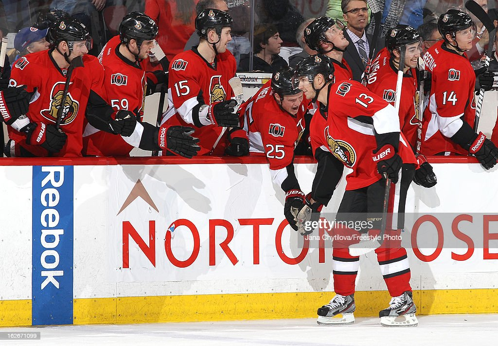 <a gi-track='captionPersonalityLinkClicked' href=/galleries/search?phrase=Peter+Regin&family=editorial&specificpeople=690589 ng-click='$event.stopPropagation()'>Peter Regin</a> #13 of the Ottawa Senators celebrates his game winning shootout goal with team mates Jim O'Brien #18, David Dziurzynski #59, Zack Smith #15, and Chris Neil #25, during an NHL game against the Montreal Canadiens, at Scotiabank Place on February 25, 2013 in Ottawa, Ontario, Canada.