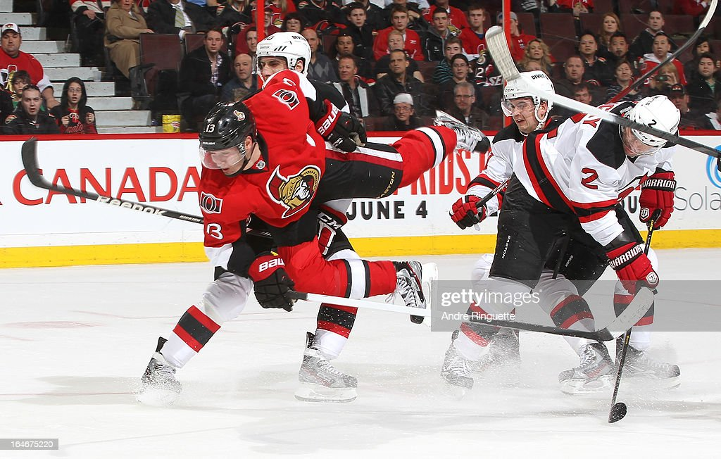 <a gi-track='captionPersonalityLinkClicked' href=/galleries/search?phrase=Peter+Regin&family=editorial&specificpeople=690589 ng-click='$event.stopPropagation()'>Peter Regin</a> #13 of the Ottawa Senators goes airborne as he tries to take the puck to the net in overtime against <a gi-track='captionPersonalityLinkClicked' href=/galleries/search?phrase=Peter+Harrold&family=editorial&specificpeople=579399 ng-click='$event.stopPropagation()'>Peter Harrold</a> #10, <a gi-track='captionPersonalityLinkClicked' href=/galleries/search?phrase=Andrei+Loktionov&family=editorial&specificpeople=5370946 ng-click='$event.stopPropagation()'>Andrei Loktionov</a> #21 and <a gi-track='captionPersonalityLinkClicked' href=/galleries/search?phrase=Marek+Zidlicky&family=editorial&specificpeople=203291 ng-click='$event.stopPropagation()'>Marek Zidlicky</a> #2 of the New Jersey Devils on March 25, 2013 at Scotiabank Place in Ottawa, Ontario, Canada.