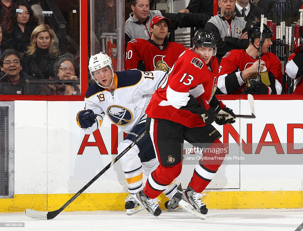 Peter Regin #13 of the Ottawa Senators skates against Cody Hodgson #19 of the Buffalo Sabres during an NHL game at Scotiabank Place on February 5, 2013 in Ottawa, Ontario, Canada.