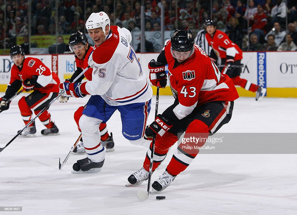 Peter Regin #43 of the Ottawa Senators steals the puck away from <a gi-track='captionPersonalityLinkClicked' href=/galleries/search?phrase=Hal+Gill&family=editorial&specificpeople=209158 ng-click='$event.stopPropagation()'>Hal Gill</a> #75 of the Montreal Canadiens in a game at Scotiabank Place on January 30, 2010 in Ottawa, Canada. The Ottawa Senators lead the Montreal Canadiens 2-1 after two periods.