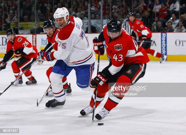 Peter Regin of the Ottawa Senators steals the puck away from Hal Gill of the Montreal Canadiens in a game at Scotiabank Place on January 30 2010 in...