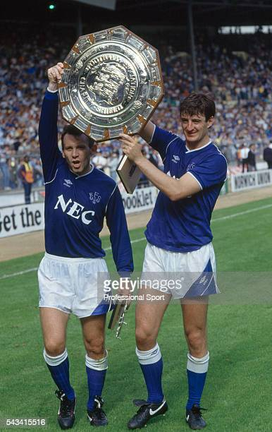 Peter Reid and Wayne Clarke of Everton parade the FA Charity Shield after the match between Everton and Coventry City at Wembley Stadium London on...
