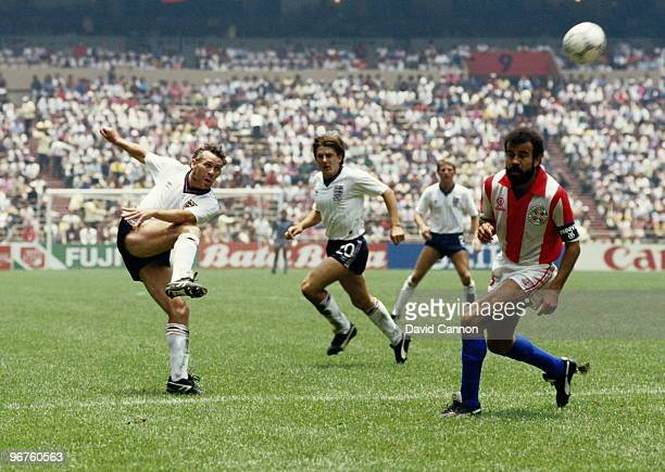 Peter Reid of England and Rogelio Delgado of Paraguay in action during round 16 of the FIFA World Cup on 18 June 1986 at the Azteca Stadium in Mexico...