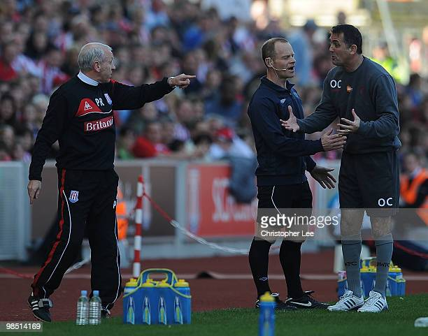 Peter Reid of Stoke and Owen Coyle of Bolton speak during the Barclays Premier League match between Stoke City and Bolton Wanderers at the Britannia...