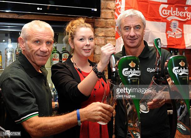 Peter Reid pub landlady Sarahanne George and Ian Rush pose for photos during the Carlsberg Ultimate Legends Pub Experience at The Crown pub on...