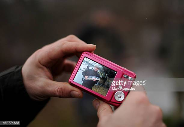 Peter Reilly looks at the image of him holding the first salmon of the season captured on a digital camera during the Traditional opening of the Tay...