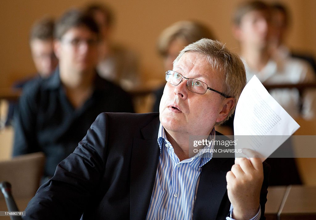 Peter Rieck, former vice chairman of the HSH Nordbank sits in the courtroom at the beginning of the second day of trial at the regional court in Hamburg, northern Germany, 29 July 2013. Six bankers of the HSH Nordbank allegedly caused a financial damage of 150 million euros in 2007 with risky businesses. AFP PHOTO/ Christian Charisius/ POOL